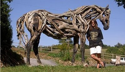 "Sculptor Heather Jansch with driftwood horse ""Beltane Juno"" Photo by Julian Hanbury"